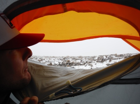 Watching Froze-To-Death Plateau get socked in by a storm from inside our little tent.