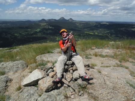 Nate enjoying the feeling of having conquered Devil's Tower.