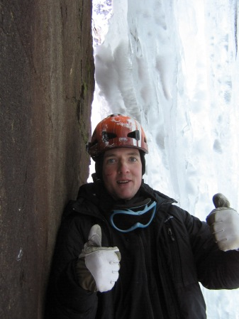 Thumbs up in the belay cave at the top of the first pitch.