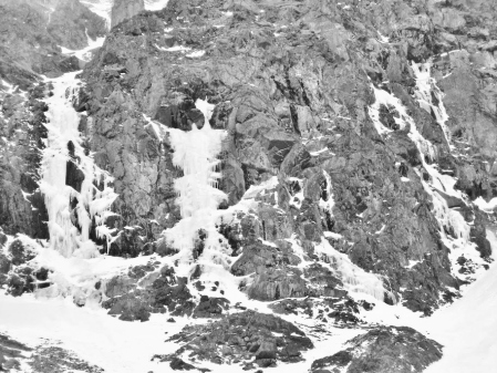 Gran Carambano (IV, WI 5, 100m) in the Froze-To-Death Cirque of the Beartooth Mountains. The route follows the large, steep flow on the far left.