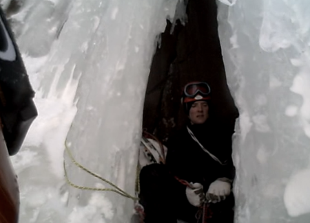 A screen shot from the helmet camera as Olin gets his first look into the belay cave.