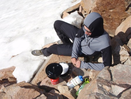 Melting snow to fill our water bottles from the glacier just below our bivouac ledge.